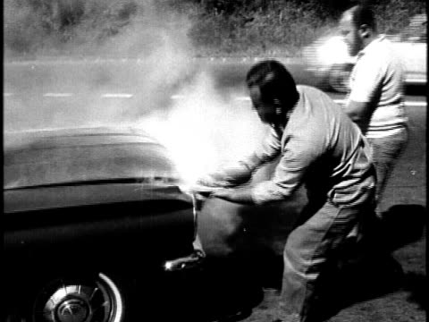 firefighters assisting men on roadside with smoking car/ hawaii islands usa - now open stock videos & royalty-free footage