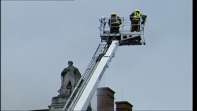 firefighters at site of fire near royal academy of arts more of fire engine in front of burlington arcade firefighters in crane above rooftop - arcade fire stock videos & royalty-free footage