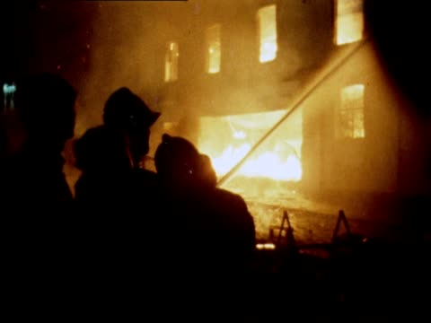firefighters attempt to put out fires during rioting in the bogside area of londonderry - ロンドンデリー点の映像素材/bロール
