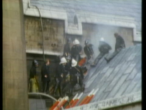 firefighters battle a blaze caused by an ira bombing of london's westminster hall. - bombing stock videos & royalty-free footage