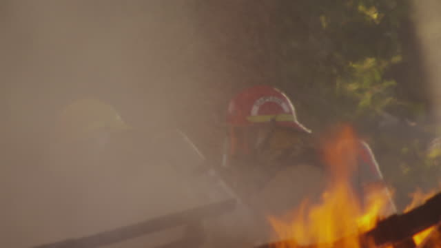 firefighters battle a fire. - firefighter stock videos & royalty-free footage