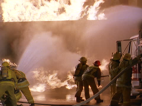 firefighters battle a raging fire. - fire engine stock videos & royalty-free footage