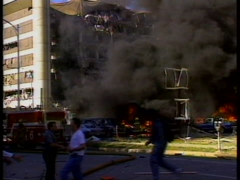 firefighters battle flames raging around parked cars near the bombed murrah federal building in oklahoma city. - oklahoma city bombing stock videos & royalty-free footage