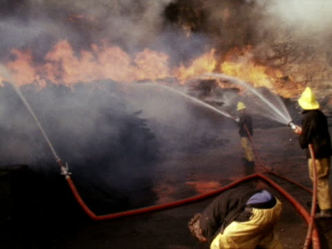 firefighters battle to control a fire at a scrapyard during the heatwave of 1976 - 1976 stock videos and b-roll footage