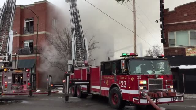 Firefighters battled an extra alarm fire near Belmont and Central Avenue in Chicago on Wednesday afternoon Water can be seen pouring from windows as...