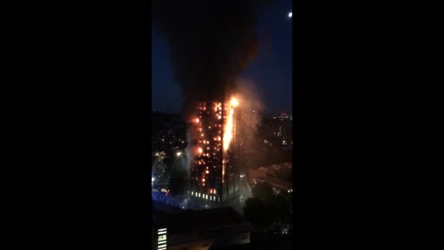 Firefighters can be seen battling the blaze as fire spreads through Grenfell Tower