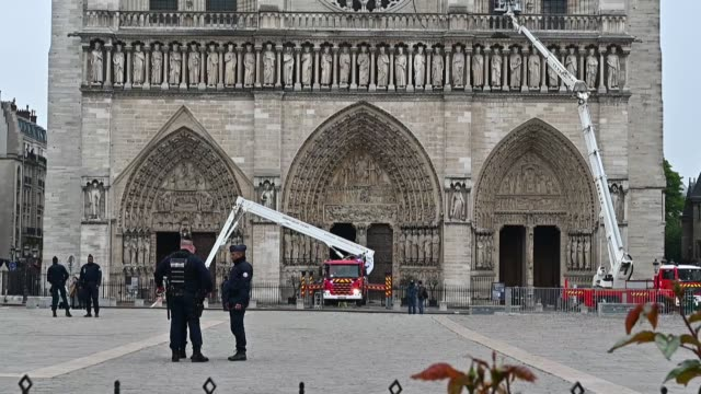 firefighters carry out inspections at notredame cathedral following a major fire yesterday on april 16 2019 in paris france prosecutors have ruled... - arson stock videos & royalty-free footage