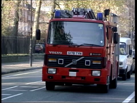 stockvideo's en b-roll-footage met firefighters' dispute latest pay offer refused/eight day strike imminent lib held red fire engine towards and past pan to bv night group of police... - getal 8