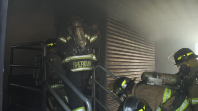 ms pan firefighters during exercises in building, ecuador - oxygen mask stock videos and b-roll footage