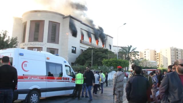 Firefighters extinguish a fire at the Foreign Affairs Ministry in Tripoli after gunfire and explosions and attackers storming the building this...