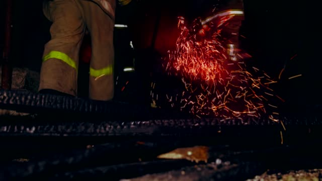 Firefighters extinguish fire at night