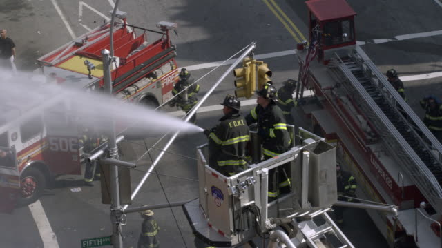 ha, zi, pan, firefighters extinguishing blaze with hoses, new york city, new york, usa - fire engine stock videos & royalty-free footage