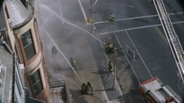 ha, zi, pan, firefighters extinguishing blaze with hoses, new york city, new york, usa - hose stock videos & royalty-free footage