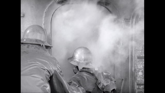 MS Firefighters extinguishing fire on warship / United States