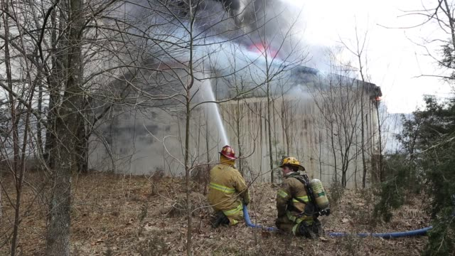 firefighters fight a fire in a furniture warehouse on ind. state road 45, january 23, 2013 in bloomington, ind. the fire quickly spread engulfing the... - 2013 stock videos & royalty-free footage