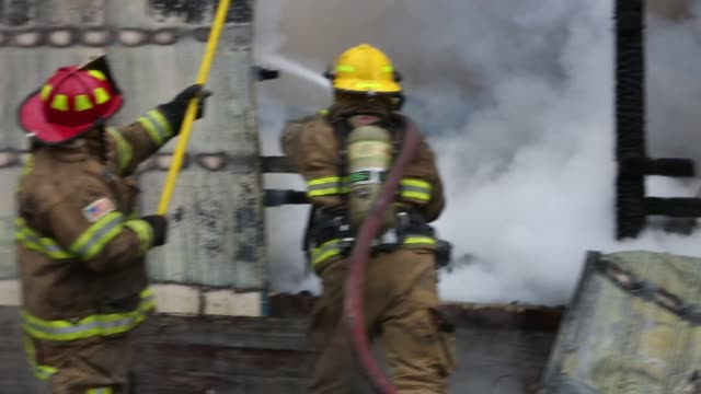 stockvideo's en b-roll-footage met firefighters fight a fire in a furniture warehouse on ind state road 45 january 23 2013 in bloomington ind the fire quickly spread engulfing the... - 2013