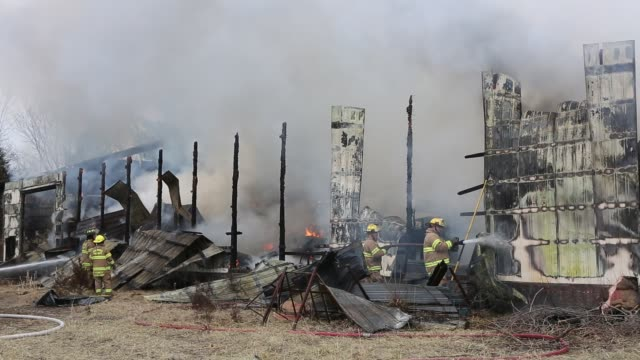 vídeos de stock, filmes e b-roll de firefighters fight a fire in a furniture warehouse on ind. state road 45, january 23, 2013 in bloomington, ind. the fire quickly spread engulfing the... - 2013