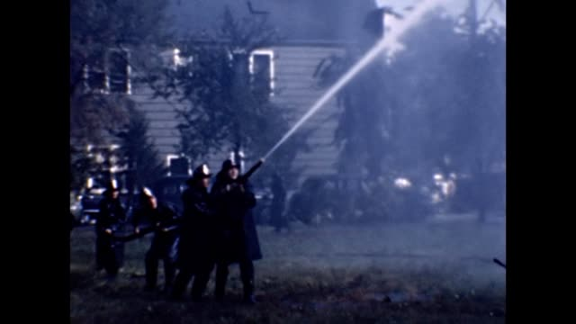 1953 Firefighters Fighting Fire With High Pressure Hose