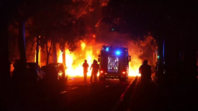 vídeos de stock e filmes b-roll de firefighters go from barricade to barricade to extinguish the fires following another night of clashes between pro independence protesters and the... - independência