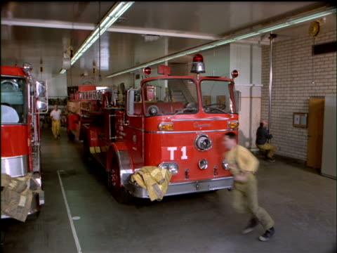 Firefighters hurrying to respond to a call.