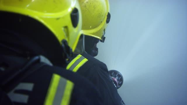 cu firefighters in action / london, england, united kingdom - retter rettungsaktion stock-videos und b-roll-filmmaterial