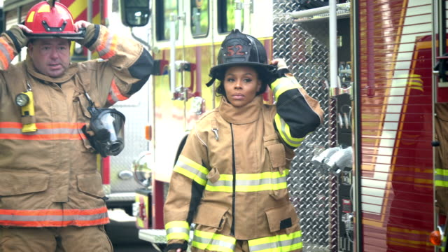 firefighters in fire protection suits ready for action - firefighter stock videos & royalty-free footage