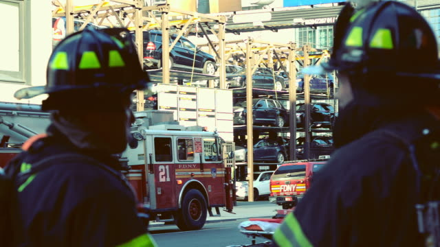 Firefighters in New York City USA with trucks