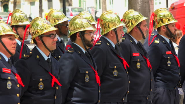 Firefighters in uniform at Miradouro de São Pedro de Alcântara on national day, Lisbon, Portugal