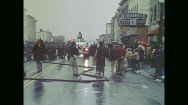 firefighters join soldiers and black residents on smoky wet baltimore street - 1968 stock videos & royalty-free footage