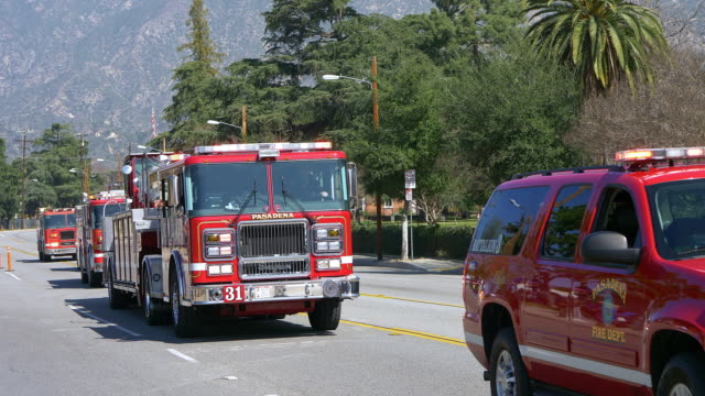 firefighters of los angeles fire department participate in annual parade in pasadena, california, 4k - pasadena california stock videos & royalty-free footage