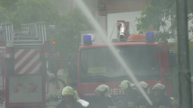 firefighters on aerial ladder - hose stock videos and b-roll footage