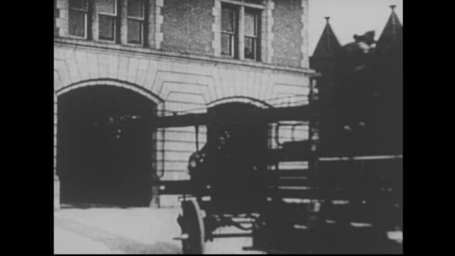 firefighters on horse drawn fire engine usa - cocchio video stock e b–roll