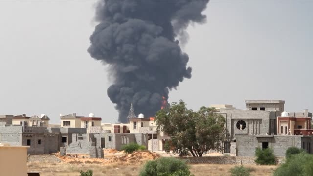 stockvideo's en b-roll-footage met firefighters on monday failed to extinguish a blaze at an oil depot on the outskirts of tripoli sparking fears of a huge fireball that could cause... - libië