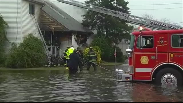 ws firefighters on outside of home on flooded street - environment or natural disaster or climate change or earthquake or hurricane or extreme weather or oil spill or volcano or tornado or flooding stock videos & royalty-free footage