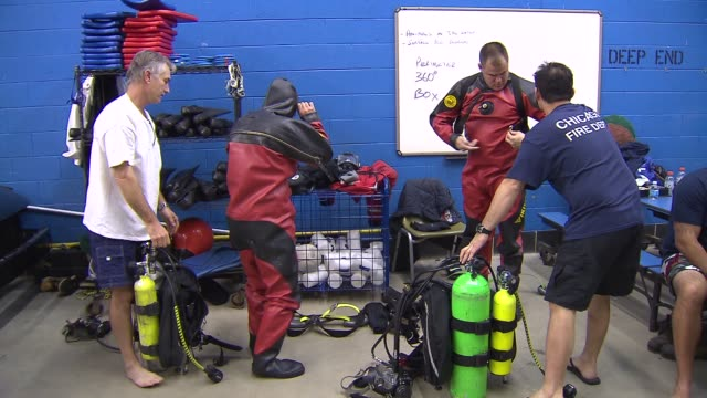 firefighters putting on wet suits on december 17, 2013 in chicago, illinois - wet wet wet stock videos & royalty-free footage