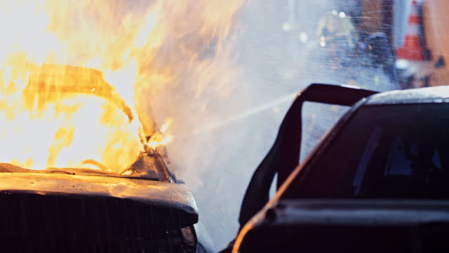 firefighters putting out a car fire at night - firefighter stock videos & royalty-free footage