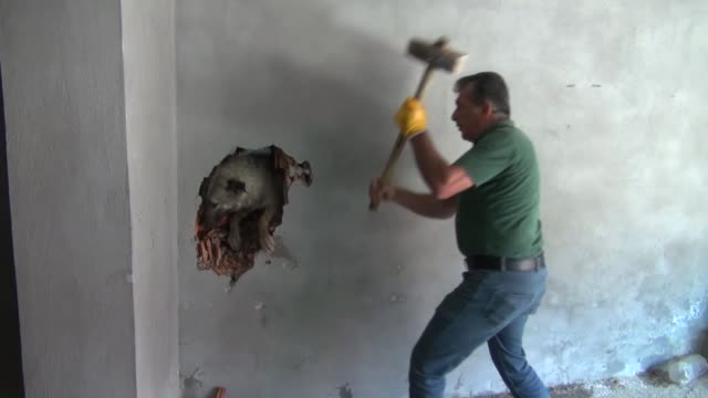 firefighters rescue a dog trapped in the gap between two walls on july 08 2019 in southeastern mardin province of turkey - stuck stock videos & royalty-free footage
