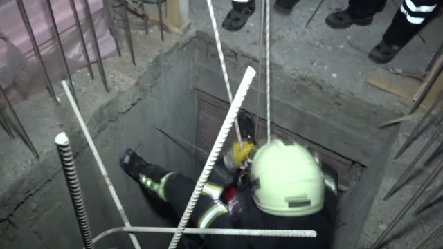 firefighters rescue a puppy that is trapped into an elevator shaft at construction site of the building in nevsehir province turkey on march 29 2017 - soccorritore video stock e b–roll