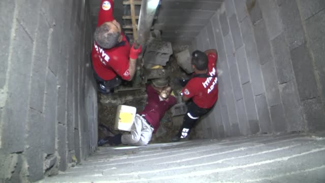 Firefighters rescue injured 50yearold man from a well in Seyhan district of Adana Turkey on May 14 2017