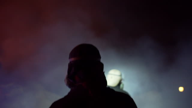 firefighters silhouetted against coloured smoke - smoke physical structure stock videos & royalty-free footage