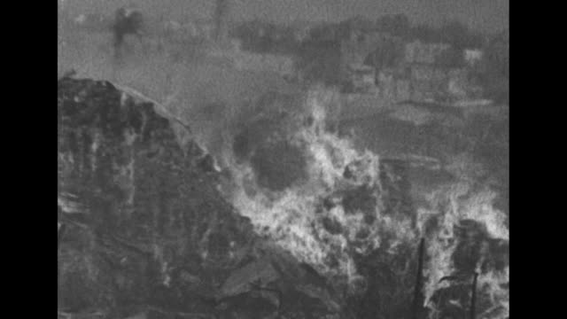 firefighters spray water on a massive fire in jaffa; men in traditional dress and a pan of the scene / note: exact day not known - ジャファ点の映像素材/bロール