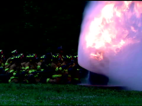 firefighters spraying water on fire - 消火ホース点の映像素材/bロール