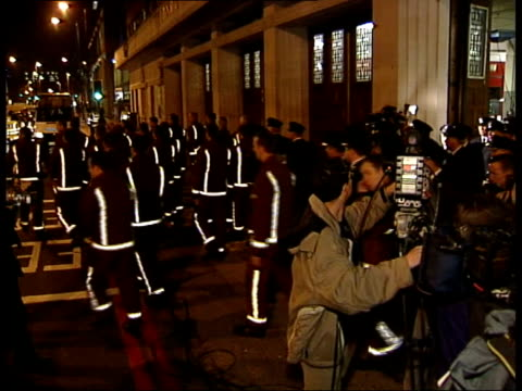 firefighters strike begins itn england london lambeth ext at night doors of fire station opening firefighters walking out of fire station to begin... - fire drill stock videos & royalty-free footage