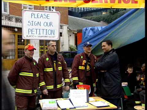 firefighter's strike new talks collapse/tony blair in darlington itn euston firefighters cutting wood brazier burning as woman signing firefighters'... - christmas poster stock videos & royalty-free footage