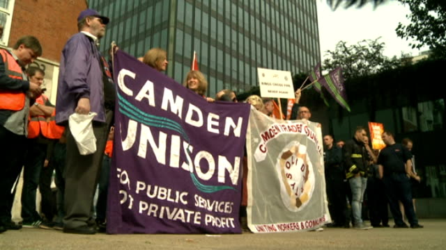 firefighters strike over pension changes london euston ext various shots of striking camden firefighters with banners and placards outside fire... - pension stock videos & royalty-free footage