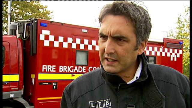 firefighters tackle blaze in croydon julian spooner interview sot - brigade stock videos & royalty-free footage