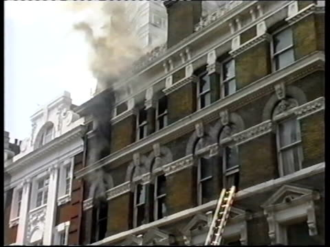 firefighters tackling fire in central london pub the george england london mortimer street ext firefighters tackling fire at above george pub on... - hoisting stock videos & royalty-free footage
