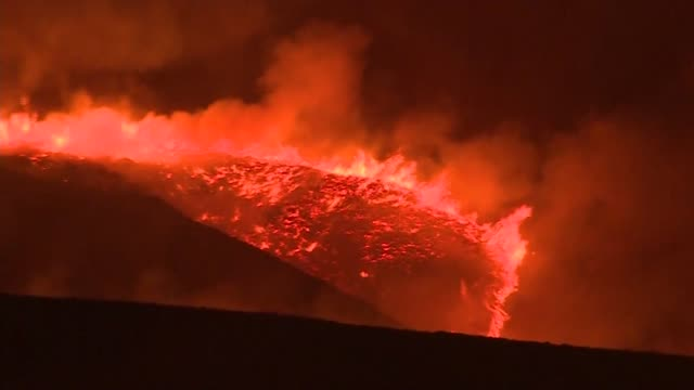 firefighters tackling saddleworth moor wildfire; england: west yorkshire: saddleworth moor: ext / night general views of burning moorland, smoke... - moor stock videos & royalty-free footage