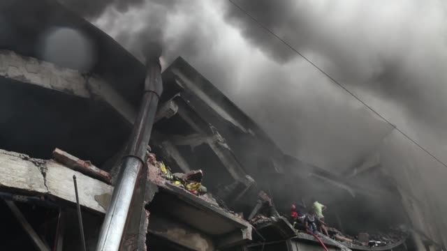 firefighters try to extinguish fire at a garment packaging factory in the industrial zone of tongi, 20 km north of dhaka, bangladesh, on september10,... - garment stock videos & royalty-free footage