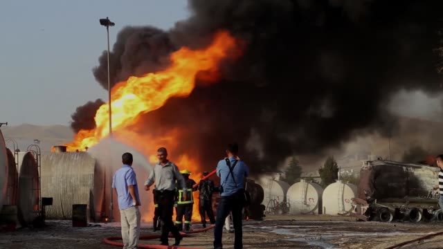 firefighters try to extinguish the fire at a fuel storage tank complex in arbat district of sulaymaniyah iraq on july 4 2017 the cause of the fire is... - fuel storage tank stock videos and b-roll footage